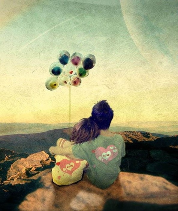 Couple-overlooking-mountains-with-moon-and-balloons